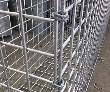 Welded gabion baskets are joined by hog rings