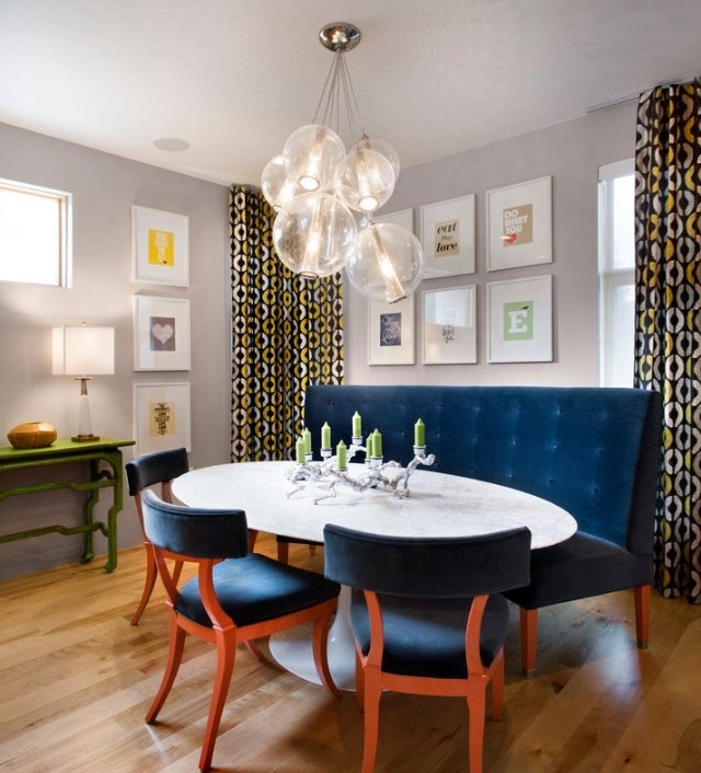 Gorgeous blue bench- love this dining area! Fantastic oval table, curved bench, artwork, and color palette!