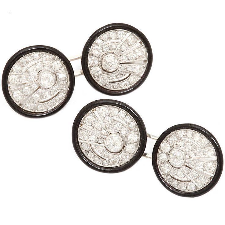 Antique Enamel Diamond Cufflinks. Pair of circular openwork platinum and diamond cufflinks with a black enamel border. France, circa 1905