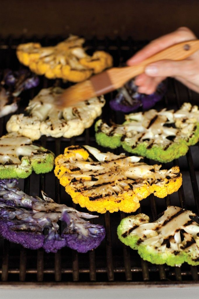 Grilled Cauliflower Steaks with Tahini Sauce. beautiful! we love, purple, green and yellow (aka cheddar) cauliflower. yum!