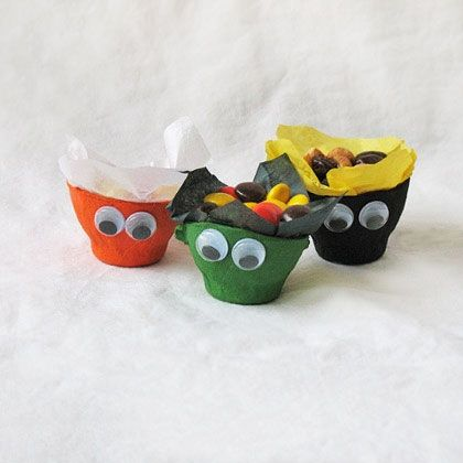 Make a fun recycled egg cup treat holder to store yummy treats. This kids' Halloween craft your child will love. They can make their own color combinations for a festive and ghoulish decoration.