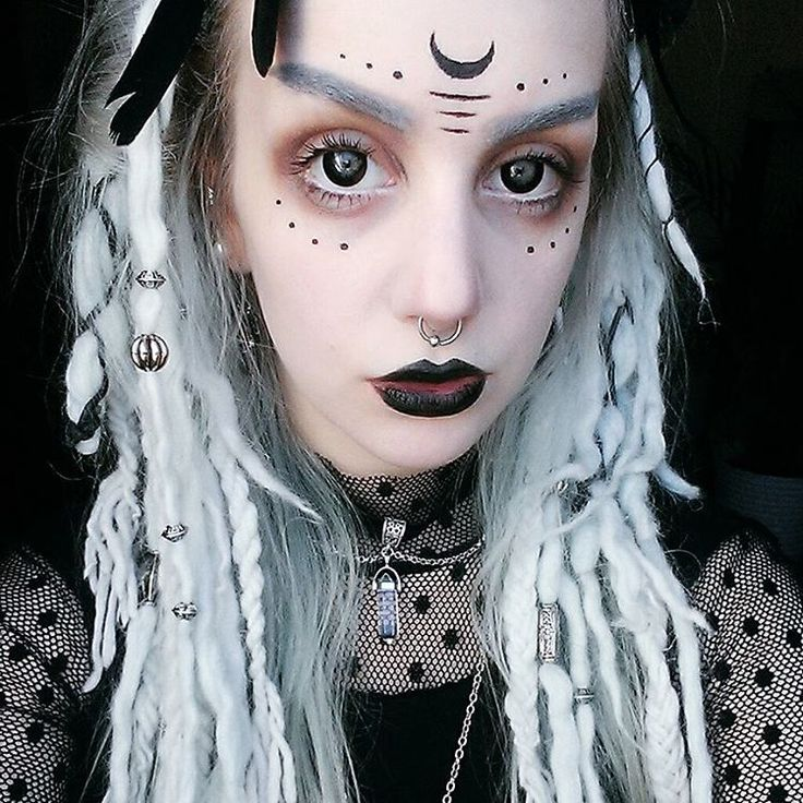 could be as simple and minimal as this. little dots and lines around the eyes and third eye area with possible crescent moon.