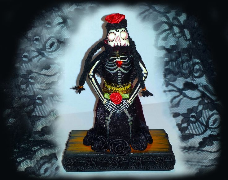 La Madame de la Morte (The Lady of Death). One of a kind sculpture of polymer clay, wood, material, and acrylic paints with satin roses and faux-ruby heart. By Ellie Gee *** MacabreWebs Studios *** 2016