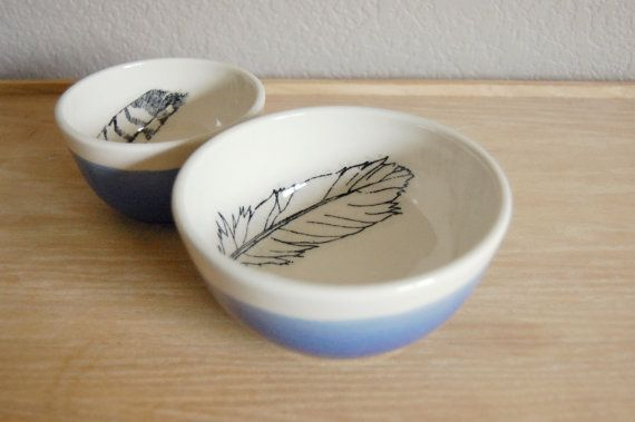 Birds of a feather, eat dinner together!  This little bowl set would be perfect for serving up your favorite side dish! Our very special image print bowls are thrown by hand on a pottery wheel. We then use a process involving linseed oil and mason stain ink to transfer an image to the bowl. It is then fired, glazed in clear to preserve the image, and fired again to Cone 6. The exterior has been dipped in a blue glaze.  Food, microwave, and dishwasher safe. Not suggested for oven use…