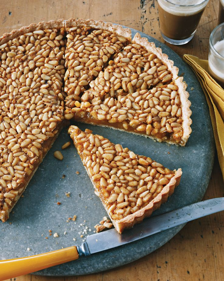 Two types of honey lend this luscious tart its elusive taste: Intensely floral leatherwood honey, which could easily overwhelm the buttery shortbread-like crust and mild pine nuts, is tempered by mellow acacia honey.