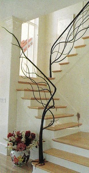Tree staircase—the bannister looks like branches!