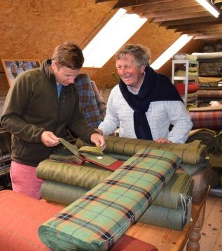 James-Sugden-OBE-and-son-John-Sugden-selecting-tweed-at-Islay-Woollen-Mill