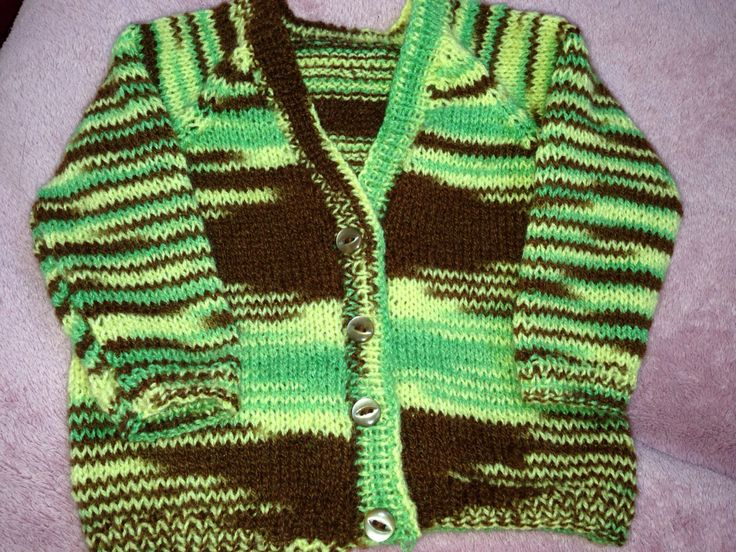 Hand knitted new born baby cardi. So pleased with the symmetry when I knitted with this variegated wool.