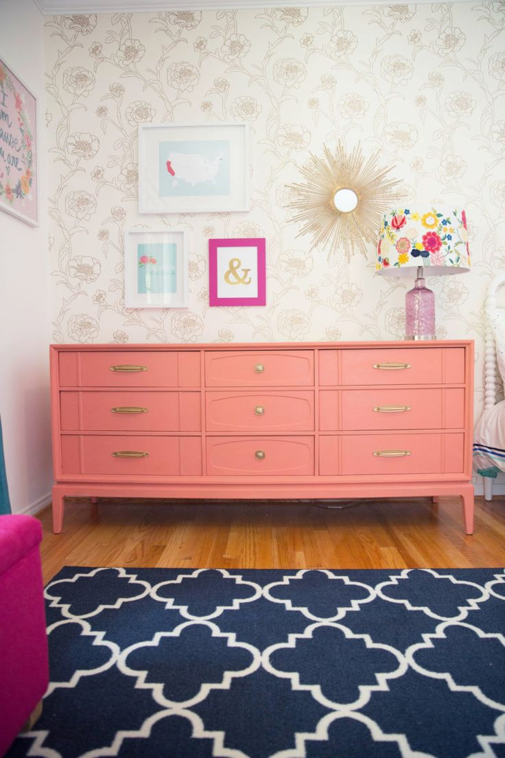 This is hip. Retro dresser upcycled with a can of coral paint!