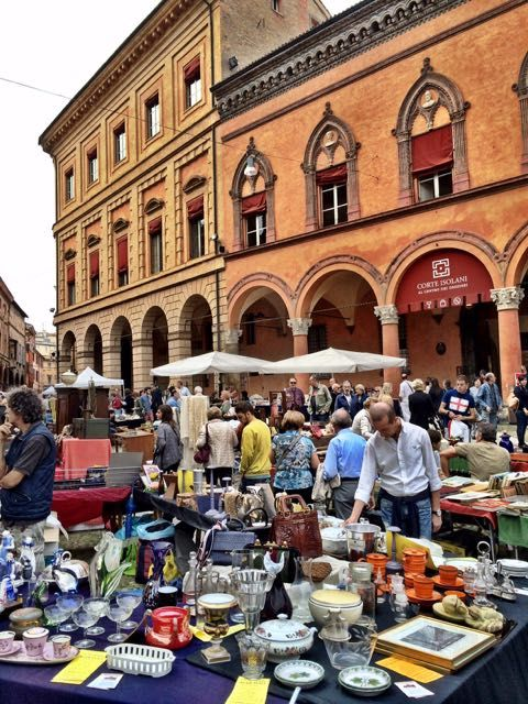 The magic of Bologna in photos - The antique market on Piazza Santo Stefano in Bologna.