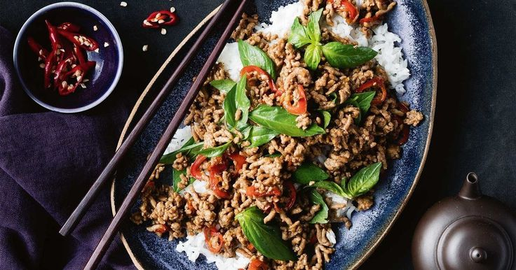 """""""This quick and easy stir-fry makes a regular appearance at my table. It's given a last-minute boost of aromatic freshness from loads of fresh Thai basil. Topping it with a crispy fried egg is a delicious, traditional touch."""" - Marion Grasby."""