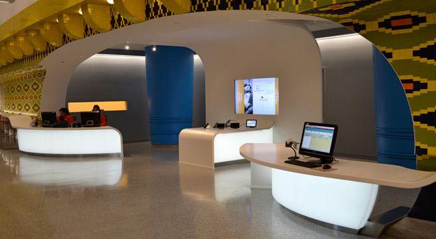 LED Backlit Curved 3Form Reception Desks - Cleveland Public Library