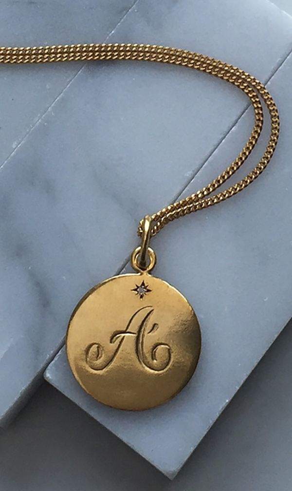 Diamond Initial Necklace in 18ct Gold Vermeil. Our Diamond Initial Necklace is inspired by traditional Victorian love tokens. Hand engraved with a scrolled initial with a brilliant-cut sparkly Diamond in a Victoriana star style setting. Layer up with the initials of those close to your heart.