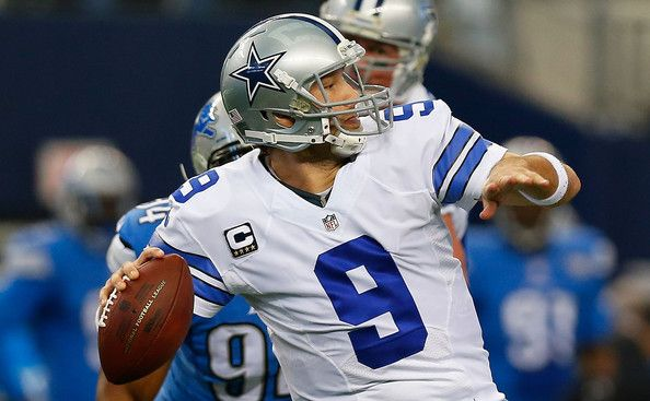 Tony Romo Photos Photos - Tony Romo #9 of the Dallas Cowboys passes against the Detroit Lions during the first half of their NFC Wild Card Playoff game at AT&T Stadium on January 4, 2015 in Arlington, Texas. - Wild Card Playoffs - Detroit Lions v Dallas Cowboys