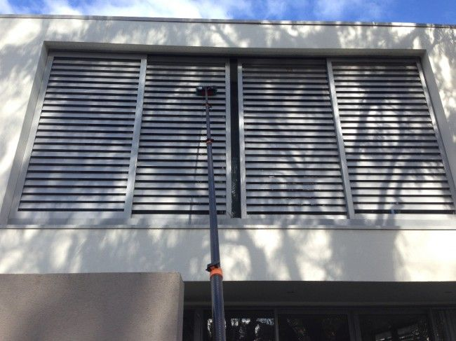 "As well as 3 storey windows, this home near Aucklands Harbour Bridge also has sliding shutters over the balconies. Window Gleam water fed pole can reach, gently clean and rinse the shutters with ""Pure Water"" for a great clean."
