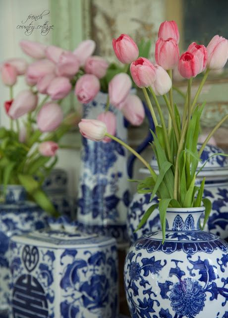 Love the Tulips, especially the color, but I'm not a fan of the white and blue vases.