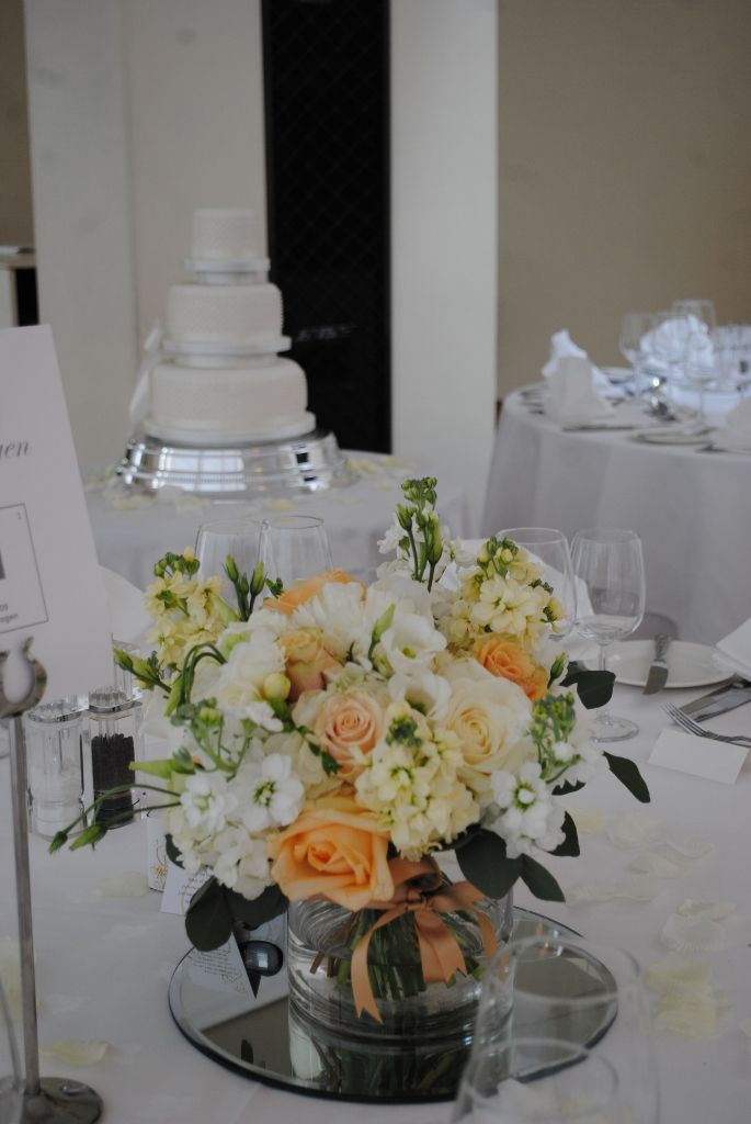 Vase Centrepiece Of Ivory Cream And Pale Gold Wedding Flowers
