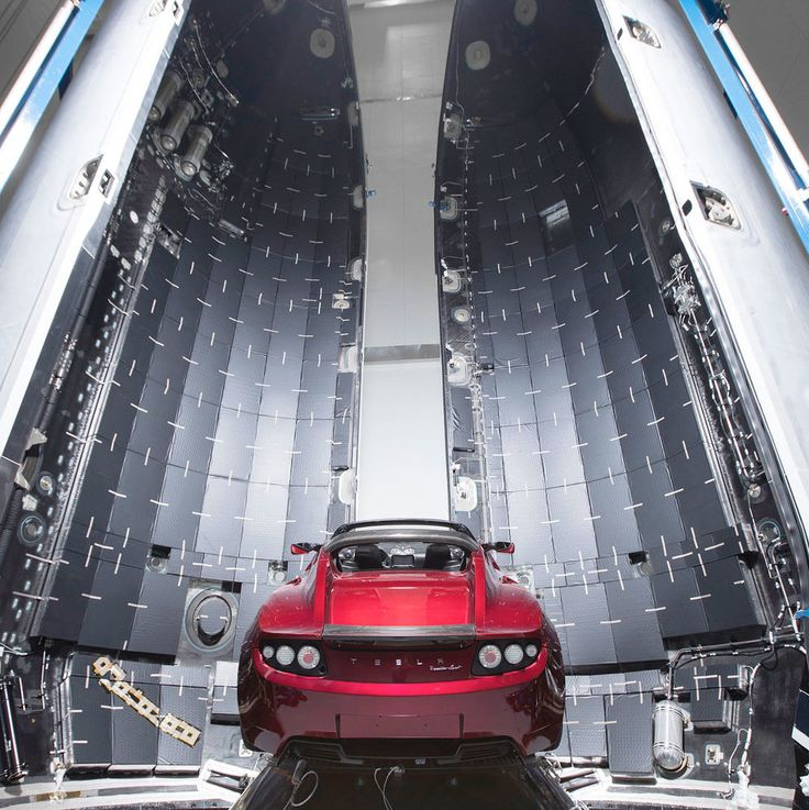 SpaceX CEO Elon Musk revealed the first photos of his midnight cherry Tesla Roadster that will launch into space on SpaceX's first Falcon Heavy rocket in January 2018.