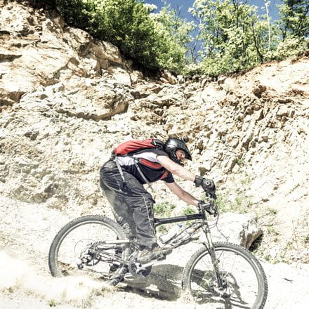 Mountain Biker in Action with mountain bike helmet more mountain bike at:http://www.bestbikepicks.com/best-mountain-bike-helmets/