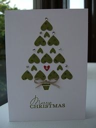 small heart punch  tiny heart for tree.  Draw triangle lightly in pencil as a guide for tree shape before arranging hearts. larger hearts punched from a piece of Old Olive CS which had been randomly stamped with snowflakes stamp. card was finished off with bow of Linen Thread and Basic Rhinestones.