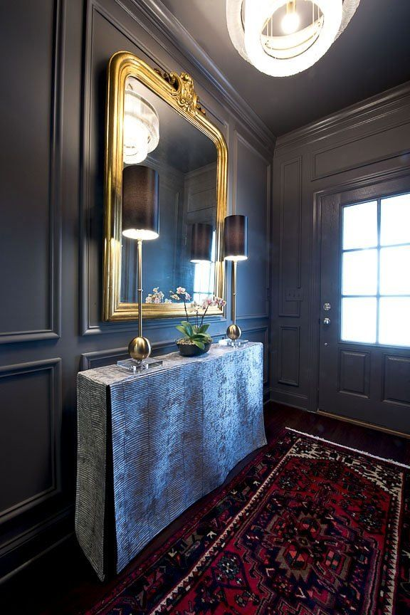 Glamor rises in this room. With walls painted in rich, dark Perle Noire SW 9154, gold and silver accents shine, while the oriental rug adds a hint of color and texture.