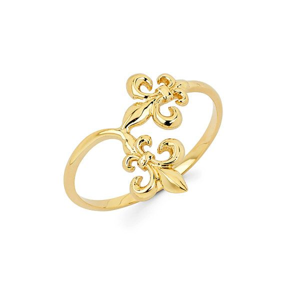 Beautiful trailing Double Fleur De Lis Ring made in Solid 14k Gold. Great for everyday Jewelry. Measures 1/2 wide.