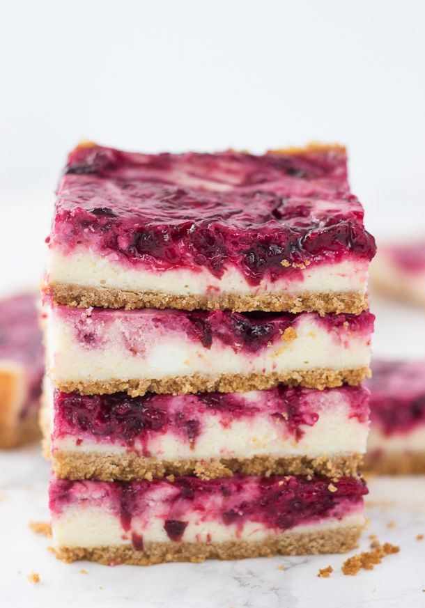 cheesecake filling is topped with a tart cherry swirl in these cherry ...