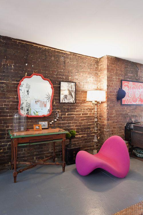 Brick wall, modern chair