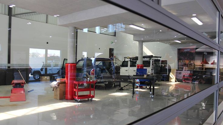 Our state-of-the-art #Fitment #Centre. see how your vehicle is fitted from the comfort of our new #showroom. — at Corner of Forssman Close and River Road, Barbeque Downs, Kyalami, Johannesburg, South Africa.