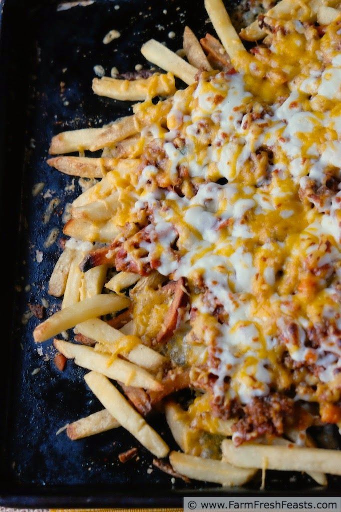 Loaded Pizza Fries (9 Better Than The Burger, Unique French Fry Recipes)- Beef and salami sauteed with farm share fresh vegetables in a seasoned tomato sauce top these baked fries. Mozzarella and cheddar cheese covers the whole pan in cheesy goodness.