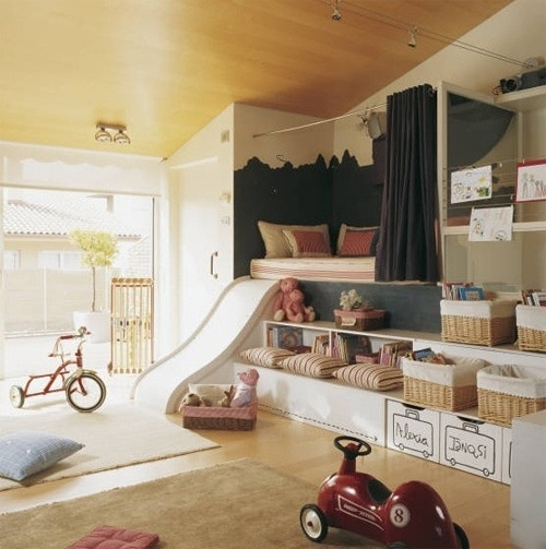 Playrooms - reading nook with slide; kids have their own labeled baskets
