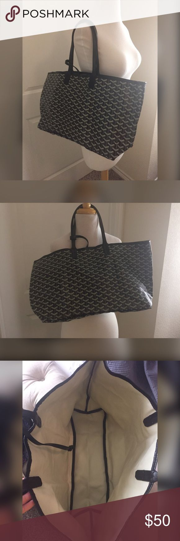 St Louis handbag E Goyard St Louis handbag. Price reflects authenticity. Bought when I went to China  does not come with attached pouchette. The string to attach is still on the bag so you could attach another one or something else like keys etc. Let me know if you have any questions  open to offers Bags