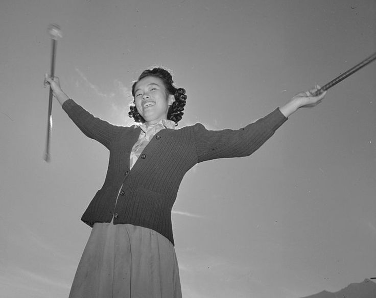 Baton practice, Florence Kuwata, Manzanar Relocation Center, 1943, Ansel Adams, public domain via Wikimedia Commons.