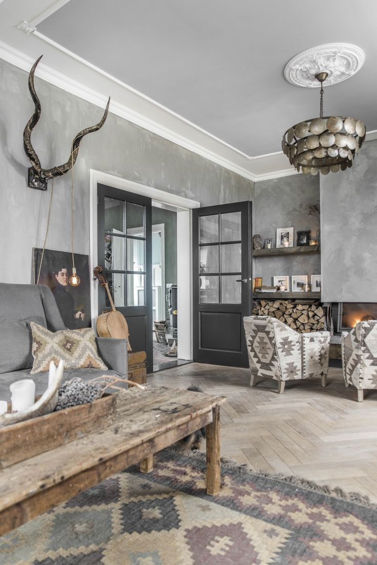 Our livingroom, painted with L'Authentique lime paint in the color 59- Beton. Sofa also made by L'Authentique. Picture taken by @paulinaarcklin