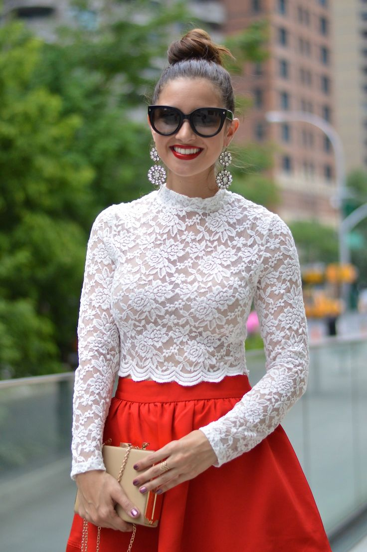 @rachelmraquel of La Mariposa conquers New York Fashion Week in a white, long-sleeve lace crop top by H&M. #HMOOTD