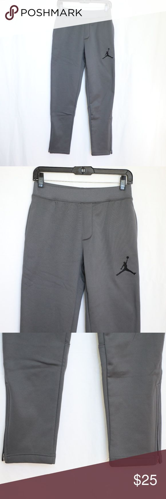"NEW Air Jordan Boys Gray Athletic Pants  Large NEW Air Jordan Boys Gray Athletic Pants  Tapered legs Zippered side ankles Drawstring waist band Pockets 8.5"" zippered sides Large NOTE: two tiny snags in front from the price tag (last photo)  Measurements are taken with garment laying flat.  Length: 38"" Waist: 13"" unstretched Jordan Bottoms"