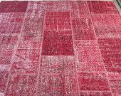 Red overdyed patchwork rug.