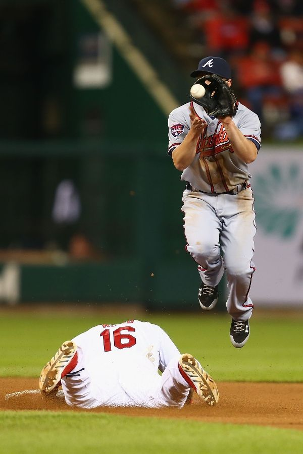Kolten Wong steals second base against Andrelton Simmons of the Atlanta Braves in the seventh inning. Cards won 5-2. 5-16-14