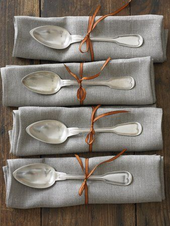 Love the touch of copper brown ribbon with the gray and silver.
