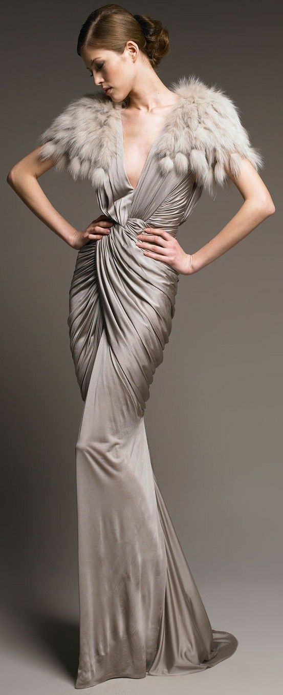 Could of done without the feather but really love the drapping, details and the structure of the dress