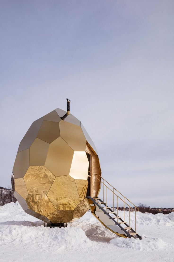 Bigert & Bergström has built a golden, egg-shaped sauna for the people of Kiruna after damage caused by decades of iron ore mining resulted in the relocation of the entire Swedish town.