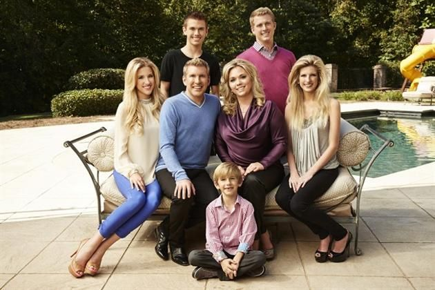 "This Oct. 2, 2013 photo released by USA Network shows the cast of ""Chrisley Knows Best,"" back row from left, Chase Chrisley and Kyle Chrisley, second row from left, Savannah Chrisley, Todd Chrisley, Julie Chrisley, and Lindsie Chrisley Campbell, and front center Grayson Chrisley, posing in Atlanta. The reality series airs on USA on Tuesdays. (AP Photo/USA Network, Tommy Garcia)"