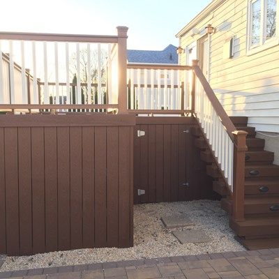 Second Story Saddle deck with Treehouse railing and Saddle Skirting with under deck storage and riser lights in Lindenhurst, NY 11757