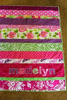 Easy, clear strip quilt tutorial.  I'd modify this for boys & use less-obnoxious fabric.
