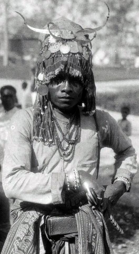 Indonesia | Meo warrior from Timor in full regalia. ca. 1950 ||| Source; Ethnic Jewellery from Indonesia: Continuity and Evolution. Bruce W Carpenter. Pg 40