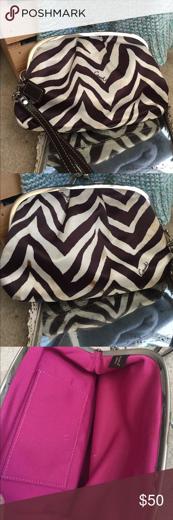 🎀Coach Clutch🎀 Used condition.  Super rare Coach Clutch with zebra print satin.  This Clutch has been well loved with satin stains (please see pictures for details) price reflects used condition.  Inside is pink fabric with side pocket, great condition.  Perfect clutch for going out ✨ Coach Bags Clutches & Wristlets