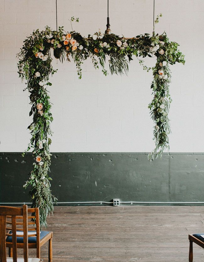 loving the idea of a lush hanging greenery alter. Love this shape, if possible with venue restrictions, add in loads of cream blooms pop of darker color