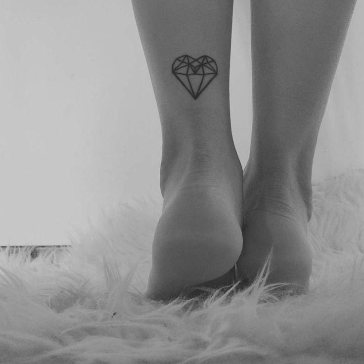Polygon heart tattoo.