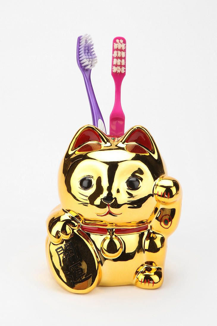 A cat home for your tooth brush from Urban Outfitters.