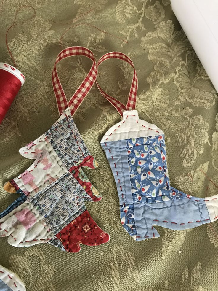 Old quilts made into Christmas ornaments. Added ribbon with fabric glue and secured with babylock Sashiko machine stitch that replicates hand stitch.